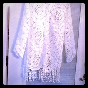 White lace button down front with fringe on bottom
